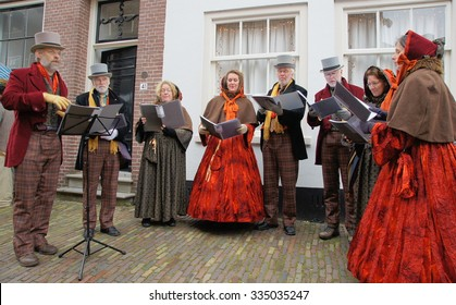 DEVENTER - NETHERLANDS ; Costumed participants at the Dickens Festival on 21 december 2014 , are singing Christmas carols to the more than 150.000 persons visiting this event.