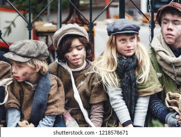 Deventer, The Netherlands,  December 21, 2014: Group of children dressed in Victorian style during the Dickens Festival in Deventer