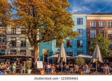 Deventer, The Netherlands - October 13, 2018: The central historic square with bars and restaurants in the ancient city center of Deventer, The Netherlands