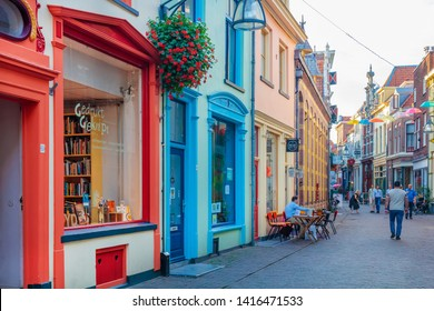 Deventer, The Netherlands - October 13, 2018: Colorful shopping street with cafe in the ancient city center of Deventer, The Netherlands