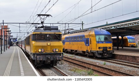 Deventer / Netherlands - September 25 2017: Three Dutch trains at the railway station of Deventer with at the left the IC (Intercity) Amsterdam - Berlin