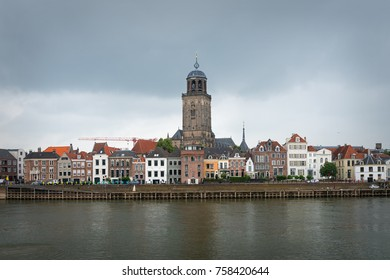 DEVENTER, OVERIJSSEL / THE NETHERLANDS - JUNE 29, 2017: View of the historic Dutch town of Deventer from the other bank of the river IJssel, The Netherlands