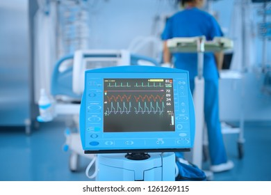 Device with the ECG monitor in the hospital ward during the work of the staff