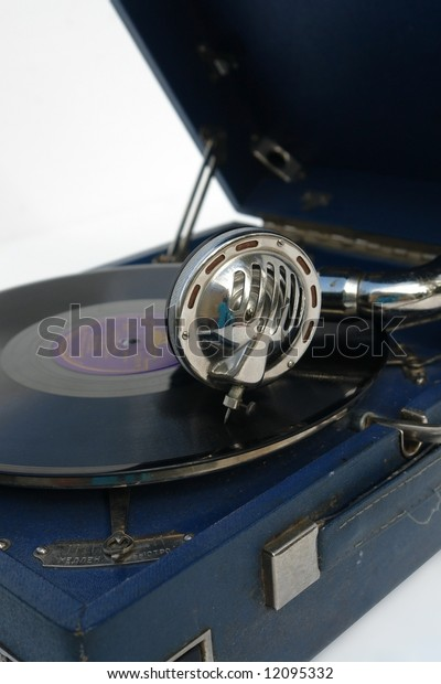 The device for playing phonograph records over white background.