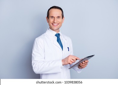 Device science wellness laptop research people person concept. Portrait of cheerful glad gifted smart with toothy smile doctor using modern pad at work isolated on gray background copy-space