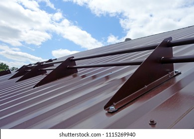 Device of snow retention on the metal roof. Building Your Home