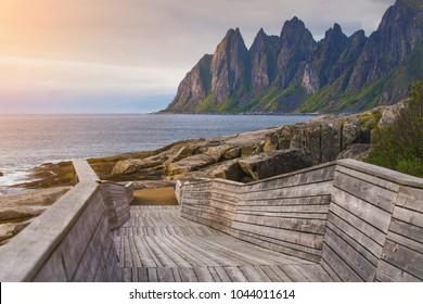 Devil Teeth rocks on Senja island in Norway. Famous stone beach at sunset.