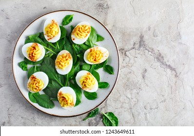 Deviled Eggs with Paprika as an Appetizer, top view, copy space