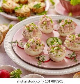 Deviled eggs, stuffed eggs filled with a paste made from smoked ham, mayonnaise, egg yolks and fresh chive on a plate.Tasty breakfast, appetizer for party or holiday meals
