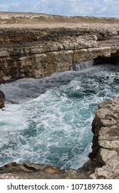 Devil's Bridge is a natural rock arch in Antigua. the arch features natural blowholes which shoot up water and spray powered by waves from the Atlantic Ocean. Antigua, Caribbean, West Indies
