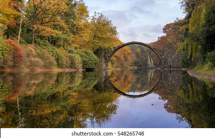 Devil's bridge in the park Kromlau, Germany,show of autumn in the park Kromlau