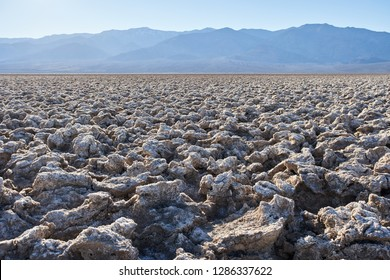 Devil's Golf Course, a large salt pan on the floor of Death Valley, located in the Mojave Desert within Death Valley National Park, California.