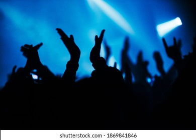 Devil's horns at a rock concert. Applause during the big show. Hands of fans at a concert
