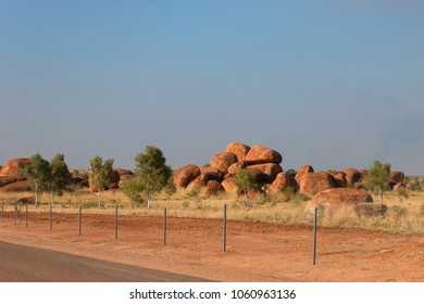 The Devil's Marbles and fence in the outback of the Northern Territory in Australia
