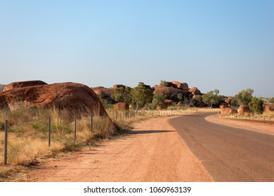 The Devil's Marbles and road in the outback of the Northern Territory in Australia