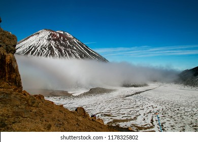 Devil's Staircase between Mt Ngauruhoe and Mt Tongariro volcano, wild volcanic landscape in New Zealand, snow covered mountain and volcanic terrain, Tongariro National Park, Tongariro Northern circuit