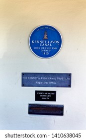 Devizes, Wiltshire / UK - June 30 2015: The John Rennie Engineer Kennet & Avon Canal opened 1810 Blue Plaque at Devizes Wharf, Wiltshire, United Kingdom.