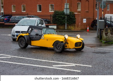 Devizes Wiltshire UK March 05 2020 A yellow Caterham 7, a continuation of the original Lotus 7, on a damp dreary morning in Devizes Wiltshire