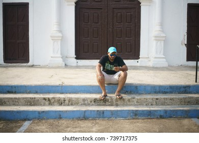 DEVKA BEACH, DAMAN, INDIA - OCTOBER 9, 2017 - A portrait of a young boy enjoying his time on a holiday, outside a local church near the Devka beach in Daman, India.