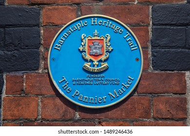 Devon, UK - August 1st 2019: A blue plaque marking the location of the Pannier Market in the town of Barnstaple in Devon, UK.