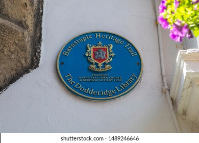 Devon, UK - August 1st 2019: A blue plaque marking the location of the Dodderidge Library in the town of Barnstaple in Devon, UK. The library is one of the earliest town libraries in England.