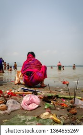 Devotees offer and praying for traditional Assamese New Year on the banks of Brahmaputra River, Guwahati, Assam state, India.