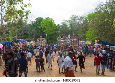 Devotees parade huge bullock effigies as part of a ritual during the Kodikkunnath Bhagavathi Temple Festival on February 26, 2019 in Chundampatta, Palakkad District, Kerala, India.