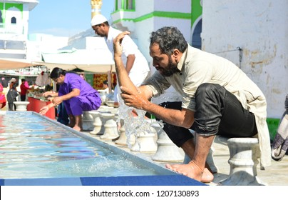 Devotees performing ablution (for prayer) at Ajmer Dargha, Rajastan on 27/12/2017