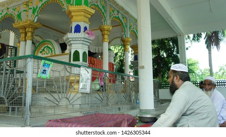 Devotees praying in the Dargah of Hazrat Ghiyasuddin Auliya at Garurachala Hills, Poa Mecca, Hajo, Assam, India also known as Barmagam on 18 October 2018