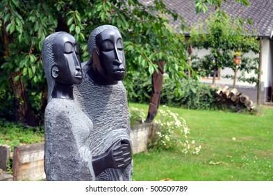 Devotional statue couple in public garden