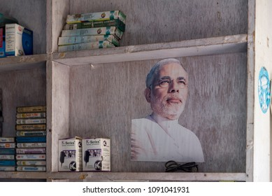 Devprayag, India - May 10, 2018: A photo of Indian Prime Minister Narendra Modi, pasted on a wooden rack.