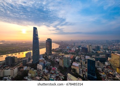 Dew and fog weather. Colourful sunrise city with clouds on Sai Gon river and center in Ho Chi Minh City (Saigon).View from a roof of Sai Gon Center building