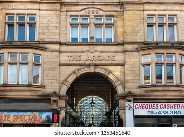 DEWSBURY, YORKSHIRE, UNITED KINGDOM - NOVEMBER 14, 2018: Unidentified people and the front facade to The Arcade, Corporation street