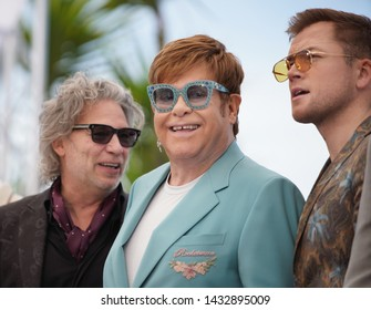 "Dexter Fletcher, Taron Egerton, Elton John attends the photocall for ""Rocketman"" during the 72nd annual Cannes Film Festival on May 16, 2019 in Cannes, France."