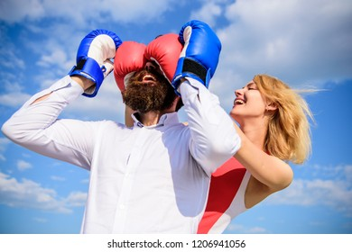 Dexterous tricks play relations. Relations game or struggle. Play and have fun. Tricks every woman needs to know. Girl smiling face covers male face boxing gloves. Break rules success. Tricky female.