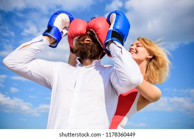 Dexterous tricks play relations. Play and have fun. Tricks every woman needs to know. Girl smiling face covers male face boxing gloves. Break rules success. Tricky female. Relations game or struggle.