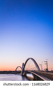 Brasília, DF, Brazil - August 12, 2018: Side view from the JK brigde in a sunset. Planned by  Alexandre Chan and Mário Vila Verde. In this photo, blue/purple sky, a calm river and natural light.