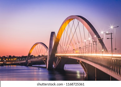 Brasília, DF, Brazil - August 12, 2018: Side view from the JK brigde in a sunset. Planned by  Alexandre Chan and Mário Vila Verde. In this photo, blue/purple sky, a calm river and long exposure.
