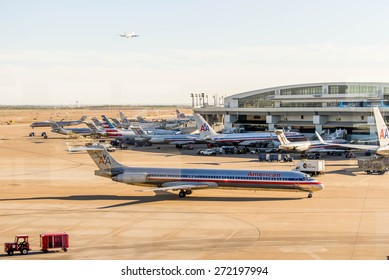 DFW, Dallas Fort Worth International Airport, Dallas, TX, USA - November 10,2014: view through a window of the airport ramp operations