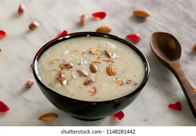 Dhabari kheer is one of the easy and tasty rice kheer from Indian cuisine. Rice is cooked with milk, sugar, cardamom and garnished with nuts.