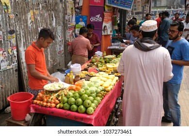 Dhaka bangladesh 1 march 2018. unrecognized man selling fresh fruits on foot path located at shantinogor in dhaka in bangladesh