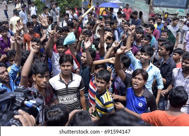 DHAKA, BANGLADESH - AUGUST 07, 2017: Bangladeshi garments workers from Meridian Fashions Ltd. block a road in Mirpur for demanding three months due wages, in Dhaka, Bangladesh on AUGUST 07, 2017.