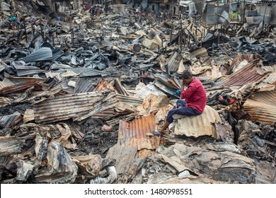 Dhaka, Bangladesh- August 17, 2019: Mohammad Helal, a slum-dweller have seen sitting beside his home after a devastating fire that broke out at Chalantika slum on Friday night in Mirpur.