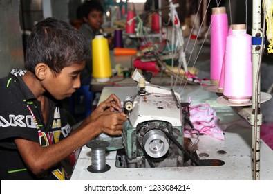 Dhaka, Bangladesh - December 08, 2014: Bangladeshi Childs working in a small garment factory at Keraniganj in Dhaka, Bangladesh on December 08, 2014.