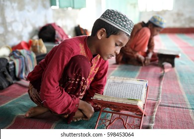 DHAKA - BANGLADESH - DECEMBER 10, 2016: Unidentified boy recites Koran texts in a madrasa on December 10, 2016 in Dhaka, Bangladesh