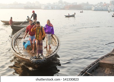 DHAKA, BANGLADESH - DECEMBER 14: Boatmen ferry passengers across a river on December 14, 2012 in Dhaka, Bangladesh. Boat travel is deeply ingrained in Bangladeshi culture.