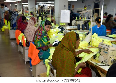 DHAKA, BANGLADESH - DECEMBER 26, 2016: Bangladeshi garments workers work inside a factory at Ashulia, in Dhaka, Bangladesh on December 26, 2016.