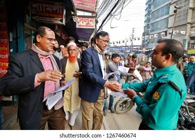 Dhaka, Bangladesh - December 26, 2018: Bangladesh nationalist party (BNP) candidate's Abdus Salam distributing leaflets as part of his election campaign at Dhaka-13 constituencies at Shyamoli in Dhaka