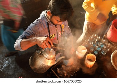 DHAKA - BANGLADESH - DECEMBER 7, 2016: Unidentified market vendor prepares tea in the market on December 7, 2016 in Dhaka, Bangladesh