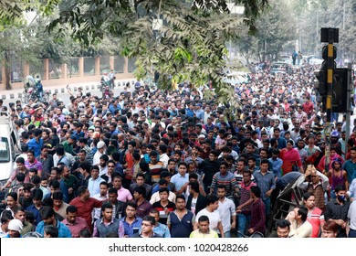 DHAKA, BANGLADESH - FEBRUARY 08, 2018: BNP activists surrounding the motorcade of Khaleda Zia on its way to the court for the verdict of Zia Charitable Trust graft case in Dhaka, Bangladesh.
